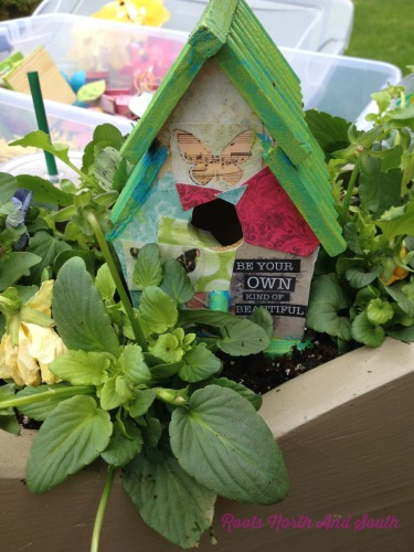 Birdhouse Among the Pansies