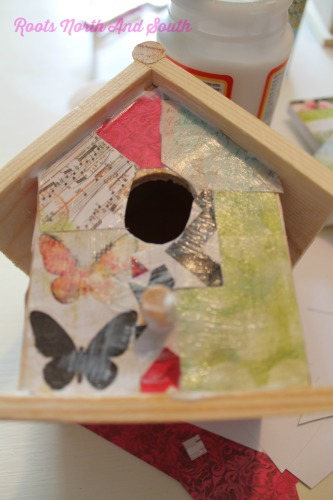 Layering on the Mod Podge on a Birdhouse